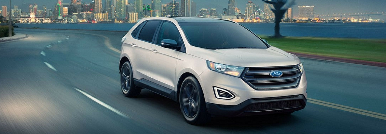 Ford Edge Driving With Metropolitan Backdrop